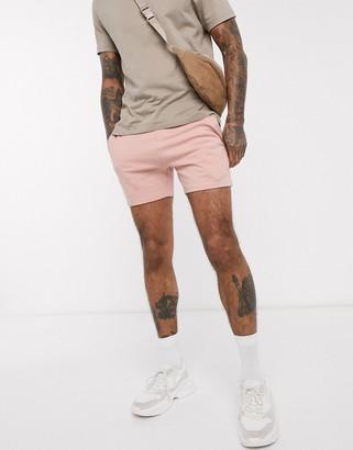 ASOS DESIGN jersey skinny shorts in shorter length in pink