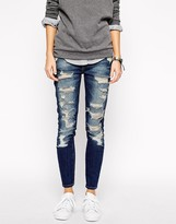 Current/Elliott Current Elliott Stiletto Mid Rise Skinny Jeans With All Over Rips & Distressing