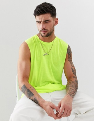 Good For Nothing cut away vest in neon yellow with script logo