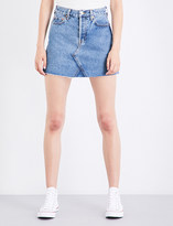 RE/DONE High-waisted distressed denim mini skirt