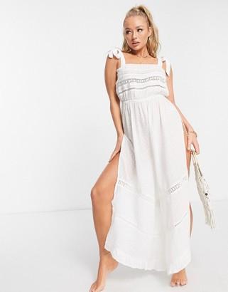Asos Design ASOS tie shoulder slit side beach jumpsuit in white dots texture