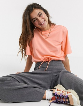 Monki crop top t-shirt with drawstring hem in peach