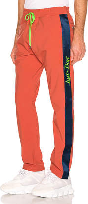 Just Don Nylon Tearaway Pant in Coral   FWRD