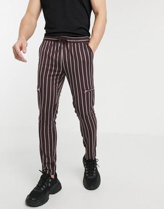 Asos DESIGN skinny pants with elastic waist in stripe with zip detail