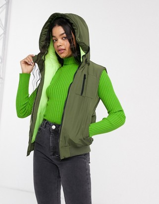 ASOS DESIGN hooded contrast gilet jacket in khaki and neon yellow