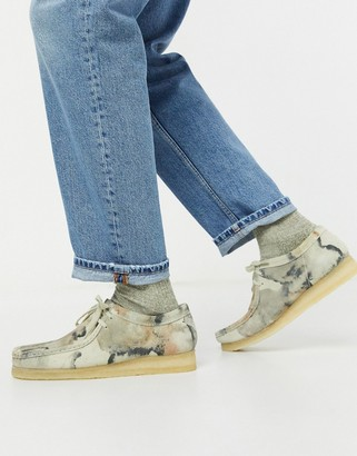 Clarks wallabee shoes in camo
