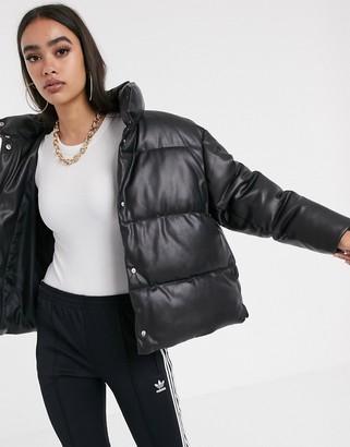 Asos Design DESIGN leather look puffer jacket-Black