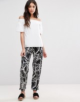 Girls On Film Print Peg Pants