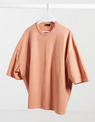 ASOS DESIGN oversized t-shirt with half sleeve in heavyweight orange acid wash