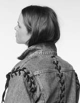 Denim jacket with lace-up details