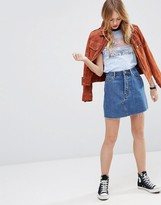 Asos Denim High Waisted Mini Skirt with Raw Hem in Midwash Blue