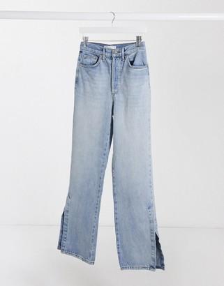 Topshop dad jeans with split hem in bleach wash