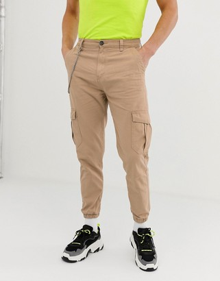 Bershka cargo trousers with chain in tan