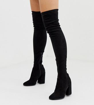 Asos DESIGN Petite Korey heeled thigh high boots in black