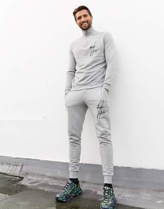 Asos Design DESIGN Dark Future tracksuit with half zip sweatshirt and skinny joggers-Grey