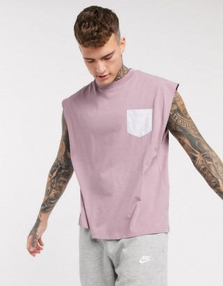 ASOS DESIGN oversized sleeveless t-shirt with contrast pocket in purple