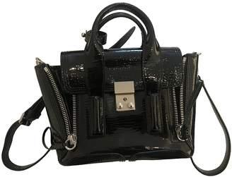 3.1 Phillip Lim Pashli Black Patent leather Handbags