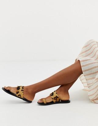 ASOS DESIGN Faro leather toe loop flat sandals in leopard