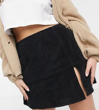 ASOS DESIGN Curve split hem skirt in black cord