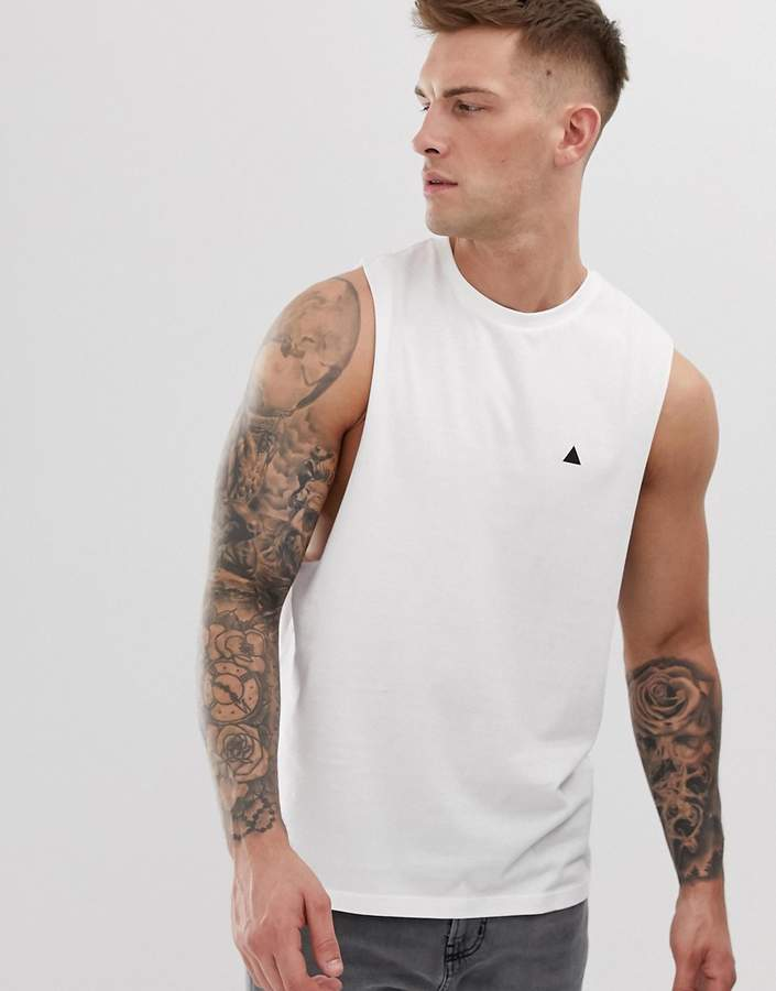 Asos Design DESIGN organic relaxed sleeveless t-shirt with dropped armhole and logo in white