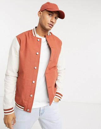 ASOS DESIGN denim varsity jacket in rust