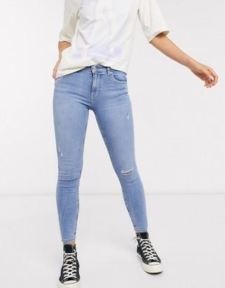 Bershka super skinny 5 pocket jeans in medium blue with knee rip