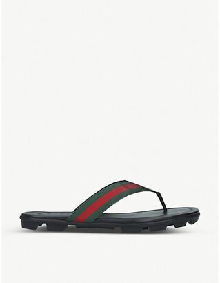 Gucci Titan leather flip-flops