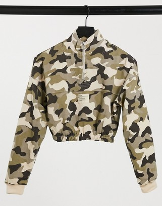 Bershka cropped half zip sweat top in camo print