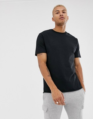 Asos DESIGN organic heavyweight relaxed fit t-shirt with crew neck and raw edges in black