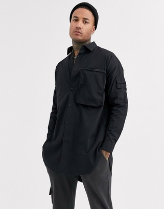 Asos Design DESIGN regular fit super longline poplin shirt with 3d zip pocket in black
