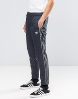 adidas Mix Logo Joggers In Gray AY8363