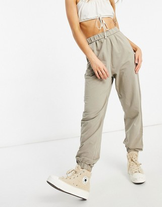 ASOS DESIGN natural dye oversized sweatpants with roll waist in khaki