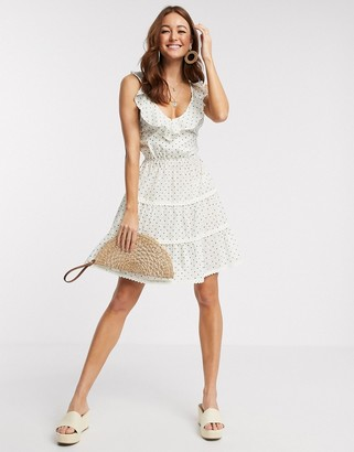 ASOS DESIGN dobby tiered mini skater sundress with lace up back in polka dot