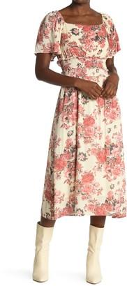 ALL IN FAVOR Floral Flutter Sleeve Midi Dress