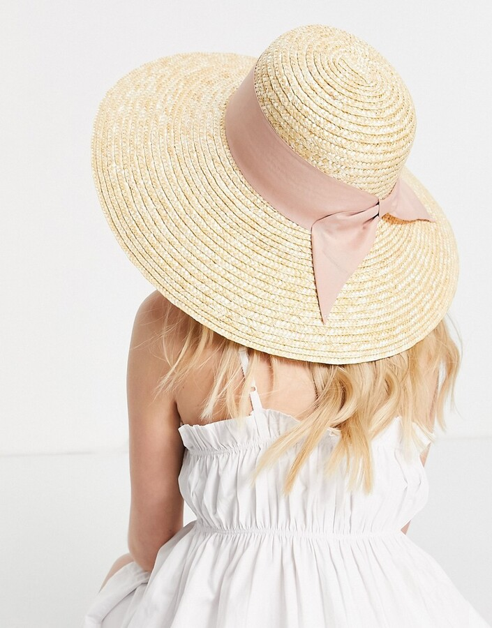 ASOS DESIGN curved crown flat brim natural straw hat with bow and size adjuster in neutral