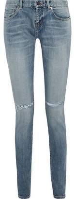 Saint Laurent Distressed Low-rise Skinny Jeans