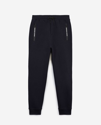 The Kooples Slim blue joggers with zipped pockets & badge