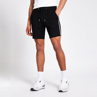 River Island Black tape side Sid skinny shorts