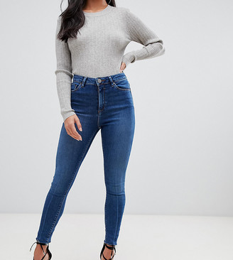 Asos DESIGN Petite Ridley high waisted skinny jeans in dark stone wash with raw hem detail