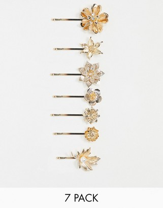 ASOS DESIGN pack of 7 hair clips in mixed floral leaf designs in gold tone