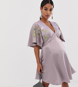 Asos DESIGN Maternity cape sleeve embroidered mini dress-Purple