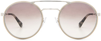 Prada Round Sunglasses in Silver & Light Brown   FWRD