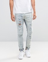 Asos Skinny Jeans With Rips In Bleach Wash