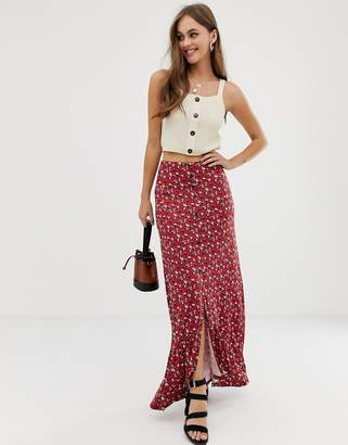 Asos Design DESIGN button front maxi skirt in floral with high low hem