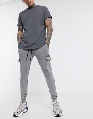 Asos Design DESIGN skinny joggers with cargo pockets in black acid wash