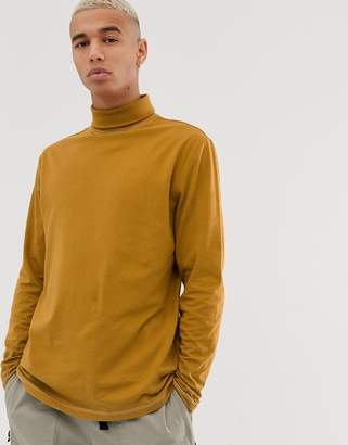 Asos Design DESIGN long sleeve relaxed jersey roll neck in contrast stitch in brown