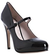 black patent leather mary-jane pumps
