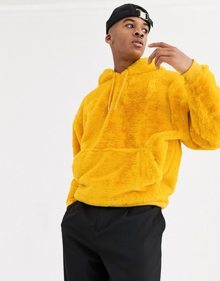 Asos Design DESIGN oversized faux fur hoodie in yellow