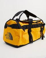 The North Face Base Camp medium duffel bag 75L in yellow