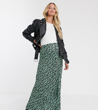 Asos DESIGN Maternity dip hem maxi skirt with button front in urban floral-Multi